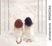 Two Pretty Girls Sitting On A...