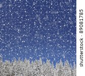 Winter background for design. Falling snow against the blue sky and trees - stock photo