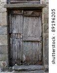 Old Wooden Door In A Gray...