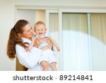 young mother in bathrobe with...   Shutterstock . vector #89214841