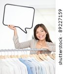 Shopping sign woman in clothing store. Small clothes business owner with speech bubble sign smiling happy behind clothes rack. Beautiful young Asian Caucasian young woman, - stock photo