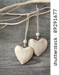 Two Wooden Hearts On Grey...