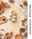 Christmas baking background: dough, cookie cutters and spices. - stock photo
