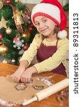Little girl baking Christmas cookies - stock photo