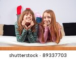 two teenage girls smiling while ... | Shutterstock . vector #89337703