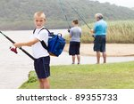 Happy Little Boy Fishing With...