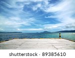 An empty boat dock on tropical beach with blue water and beautiful scenery. This picture taken in one of the most beautiful travel and diving destination on earth. Raja Ampat Island, Papua, Indonesia. - stock photo