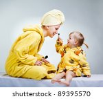daughter and mother putting... | Shutterstock . vector #89395570