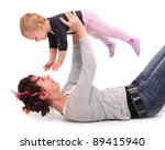 Young happy mother playing with her child. - stock photo