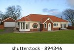 Luxury UK bungalow with garage - stock photo