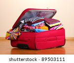 open red suitcase with clothing ... | Shutterstock . vector #89503111