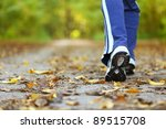 Stock photo woman walking cross country and trail in autumn forest 89515708