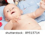 baby boy in diaper on white, blue eye - stock photo