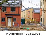 Social housing development with workers - stock photo