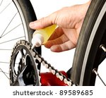 Bicycle Maintenance- oiling the chain - stock photo