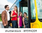 Passengers Boarding A Bus At A...