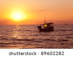 Fishing Boat In Sunrise At...