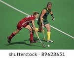 BLOEMFONTEIN, SOUTH AFRICA - FEBRUARY 8: Charlotte de Vos (L) and Tarryn Bright (R) during a womens field hockey match between South Africa and Belgium, Bloemfontein, South Africa, 8 February 2011 - stock photo