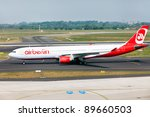 DUSSELDORF, GERMANY - MAY 21: Airbus A330 lands on May, 21 2011 in Dusseldorf airport, Dusseldorf, Germany.The AirBerlin is the second largest airline in Germany. - stock photo