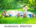 children laying on grass.... | Shutterstock . vector #89667310