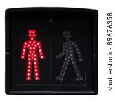 Small photo of Pedestrian traffic lights on white background