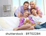 a young family of four with a... | Shutterstock . vector #89702284
