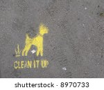 Stock photo a sprayed on sign asking dog walkers to clean up their mess 8970733