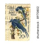 Old postage stamps from USA with two birds - stock photo