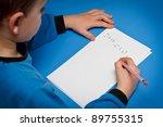 boy writing to santa | Shutterstock . vector #89755315
