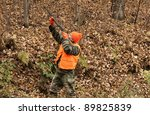 hunter aiming his weapon in the autumn woods - stock photo