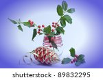 Christmas is coming composition with holly berry with blue vignette. - stock photo