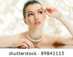 portrait of beautiful woman with jewelry - stock photo