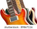 Closeup of four electric guitars on white. - stock photo