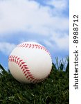 baseball sitting on grass with... | Shutterstock . vector #8988712