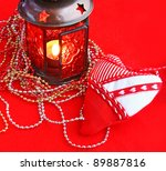 Christmas background with a beautiful red lanterns on a red background - stock photo