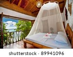 Stock photo rural style bedroom with canopy bed with sea view 89941096