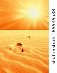 footprint in the desert with hot sun - stock photo