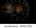 Fireworks at night - Colourful fireworks bursts on a black sky, long exposure. Celebration time! - stock photo