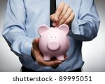 male hand putting coin into a... | Shutterstock . vector #89995051