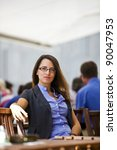 Pretty young woman sitting in a garden restaurants and enjoys her break from work. - stock photo