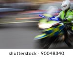 driving police motorcycle with motion blur - stock photo