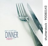 Restaurant menu series. Wedding or dinner table place setting. Fork and knife and glass in elegant setting with copyspace - stock photo