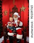 Baby Boy Sitting On Santa's La...