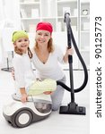 Cleaning day - woman and little girl preparing to tidy up - stock photo