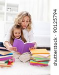 Reading a book with mom - little girl first spelling exercises - stock photo