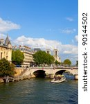 Seine river with tourists ships and cathedral Notre Dame in the background. Paris, France. - stock photo