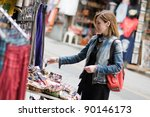Woman Shopping In A Street...