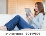 young woman reading e book on...   Shutterstock . vector #90149509