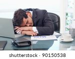 Tired Businessman Sleeping In...