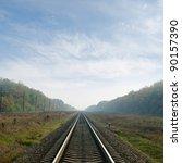 railway goes to horizon in fog